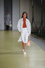 Model Joan Smalls wears a creation as part of the Salvatore Ferragamo 2021 women's spring-summer ready-to-wear collection during the fashion week in Milan, Italy, Saturday, Sept. 26, 2020. (AP Photo/Antonio Calanni)