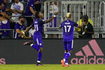 Orlando City midfielder Andres Perea, left, celebrates his goal against the Philadelphia Union with teammate forward Nani (17) who made an assist during the second half of an MLS soccer match, Thursday, July 22, 2021, in Orlando, Fla. (AP Photo/John Raoux)