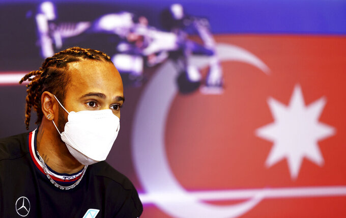 Mercedes driver Lewis Hamilton of Britain speaks during a media conference ahead of the Formula One Grand Prix at the Baku Formula One city circuit in Baku, Azerbaijan, Thursday, June 3, 2021. The Azerbaijan Formula One Grand Prix will take place on Sunday. (Francois Nel, Pool via AP)