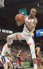 Virginia forward Mamadi Diakite pulls down a rebound against Louisville during the first half of an NCAA college basketball game in Charlottesville, Va., Saturday, March 7, 2020. (AP Photo/Lee Luther Jr.)