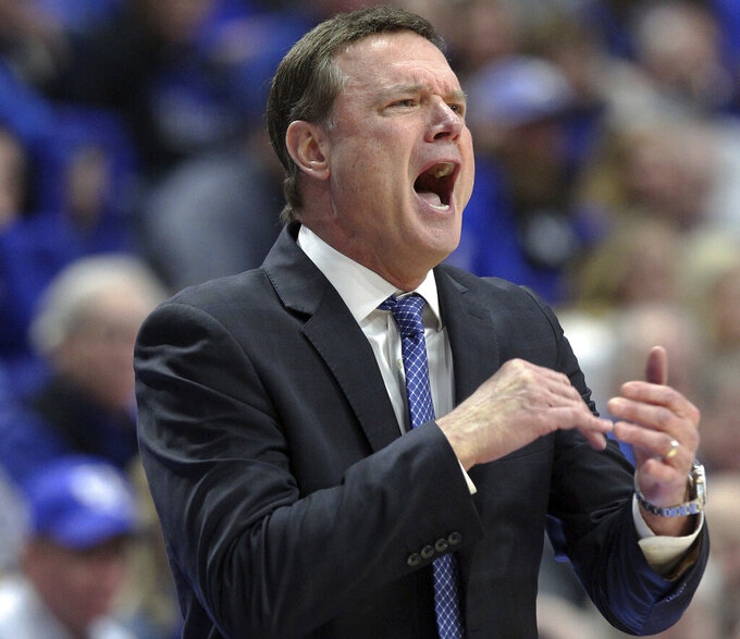 Washington helps No. 8 Kentucky top No. 9 Kansas 71-63