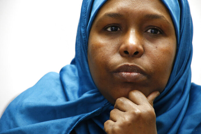 Fadumo Hussein, 45, a Muslim refugee from Somalia, listens during an interview in Columbus, Ohio, on Tuesday, Feb. 20, 2018. Weeks before the announcement of President Donald Trump's ban on arrivals from several, mostly Muslim countries, Hussein's parents, who are 75 and 76, had been approved for entry to the U.S. Their arrival was scheduled for February 2017. More than a year later, they remain stuck in Uganda, their case on hold. (AP Photo/Martha Irvine)