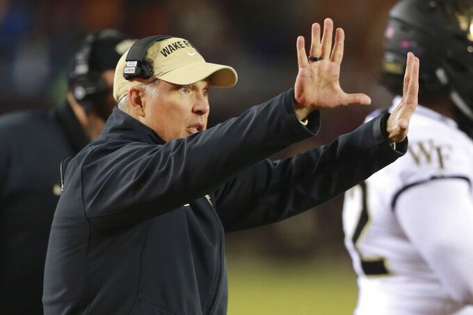 Wake Forest head coach Dave Clawson directs his team during the second half of an NCAA college football game in Blacksburg, Va., Saturday, Nov. 9, 2019. Virginia Tech defeated Wake Forest 36-17. (AP Photo/Steve Helber)