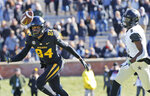 Missouri wide receiver Emanuel Hall, left, is unable to catch a pass as Vanderbilt cornerback Joejuan Williams defends during the first half of an NCAA college football game Saturday, Nov. 10, 2018, in Columbia, Mo. (AP Photo/Jeff Roberson)