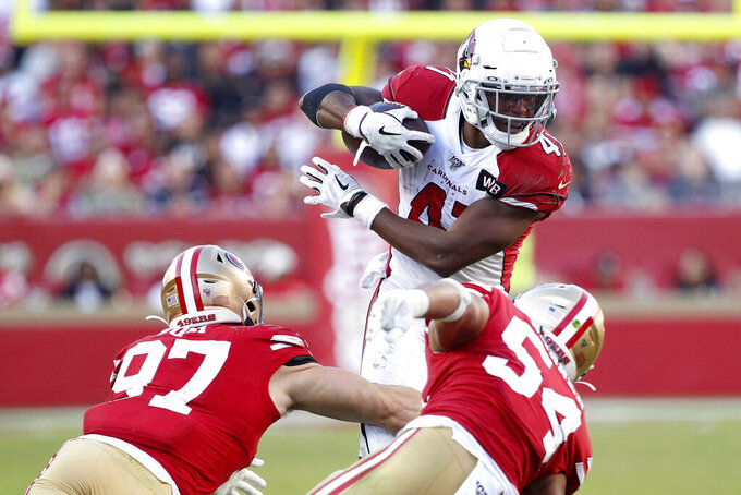 Arizona Cardinals running back Kenyan Drake (41) runs against San Francisco 49ers defensive end Nick Bosa (97) and middle linebacker Fred Warner (54) during the second half of an NFL football game in Santa Clara, Calif., Sunday, Nov. 17, 2019. (AP Photo/Josie Lepe)