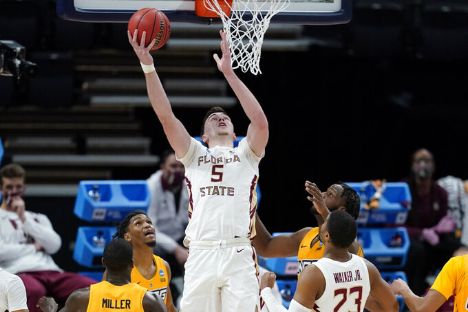 Florida State's Balsa Koprivica (5) puts back a rebound basket during the second half of a first-round game against UNC-Greensboro in the NCAA men's college basketball tournament at Banker's Life Fieldhouse, Saturday, March 20, 2021, in Indianapolis. Florida State defeated UNC-Greensboro 64-54. (AP Photo/Darron Cummings)