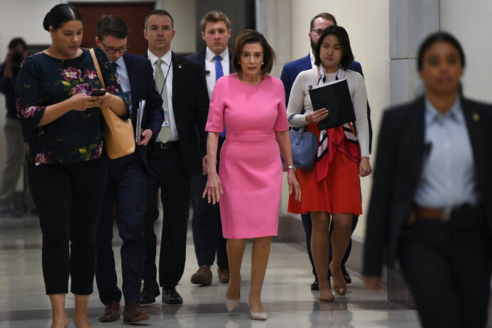 House Speaker Nancy Pelosi of Calif., heads to a news conference on Capitol Hill in Washington, Thursday, March 26, 2020. (AP Photo/Susan Walsh)