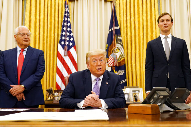 President Donald Trump speaks in the Oval Office at the White House, Thursday, Aug. 13, 2020, in Washington. Trump said on Thursday that the United Arab Emirates and Israel have agreed to establish full diplomatic ties as part of a deal to halt the annexation of occupied land sought by the Palestinians for their future state. White House senior adviser Jared Kushner is at right. (AP Photo/Andrew Harnik)
