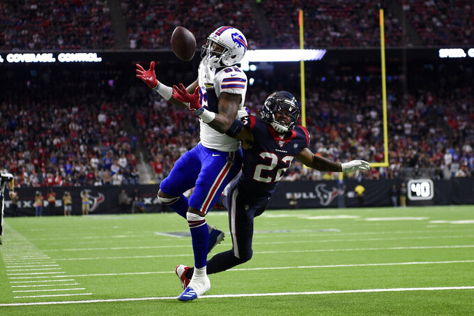 Houston Texans cornerback Gareon Conley (22) breaks up a pass intended for Buffalo Bills wide receiver Duke Williams (82) during the second half of an NFL wild-card playoff football game Saturday, Jan. 4, 2020, in Houston. The Texans won 22-19 in overtime.(AP Photo/Eric Christian Smith)