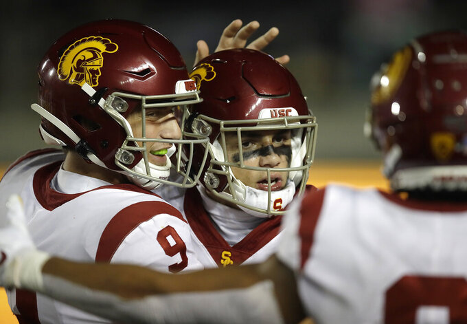 Southern California quarterback Kedon Slovis (9) celebrates with Drake London after London's touchdown against California in the second half of an NCAA college football game Saturday, Nov. 16, 2019, in Berkeley, Calif. (AP Photo/Ben Margot)