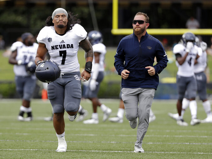 Nevada linebacker Gabriel Sewell (7) runs off the field after being ejected for targeting in the second half of an NCAA college football game against Vanderbilt, Saturday, Sept. 8, 2018, in Nashville, Tenn. (AP Photo/Mark Humphrey)