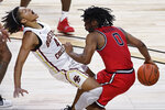 St. John's Posh Alexander, right, fouls Boston College's Makai Ashton-Langford, left, in the second half of an NCAA college basketball game, Monday, Nov. 30, 2020, in Uncasville, Conn. (AP Photo/Jessica Hill)