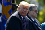 President Donald Trump sits with Attorney General William Barr during the 38th Annual National Peace Officers' Memorial Service at the U.S. Capitol, Wednesday, May 15, 2019, in Washington. (AP Photo/Evan Vucci)