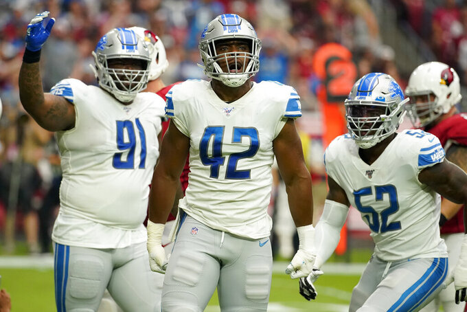 Detroit Lions defensive tackle A'Shawn Robinson (91), outside linebacker Devon Kennard (42) and outside linebacker Christian Jones (52) celebrate a sack again the Arizona Cardinals during the first half of an NFL football game, Sunday, Sept. 8, 2019, in Glendale, Ariz. (AP Photo/Rick Scuteri)