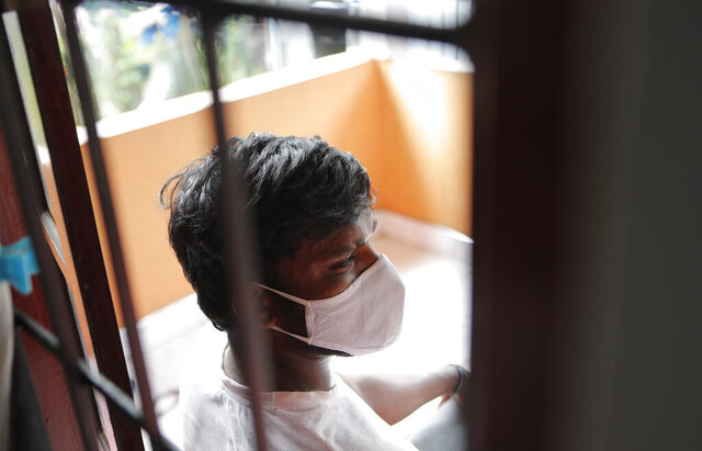 "Sri Lankan auto rickshaw driver Prasad Dinesh, linked by Sri Lankan officials to nearly half the country's more than 2,600 coronavirus cases, sits in his house in Ja-Ela, Sri Lanka, Wednesday, July 1, 2020. For months he's been anonymous, but now Dinesh is trying to clear his name and shed some of the stigma of a heroin addiction at the root of his ordeal. Referring to him only as ""Patient 206,"" government officials lambasted Dinesh on TV and social media, blaming him for at least three clusters of cases, including about 900 navy sailors who were infected after an operation in Ja-Ela, a small town about 19 kilometers (12 miles) north of the capital, Colombo. Dinesh, however, says his drug addiction, which is considered a crime in Sri Lanka, makes him a convenient scapegoat. (AP Photo/Eranga Jayawardena)"