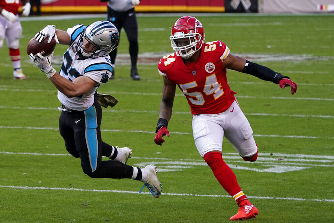 Carolina Panthers running back Christian McCaffrey, left, catches a pass in front of Kansas City Chiefs outside linebacker Damien Wilson (54) during the second half of an NFL football game in Kansas City, Mo., Sunday, Nov. 8, 2020. (AP Photo/Jeff Roberson)