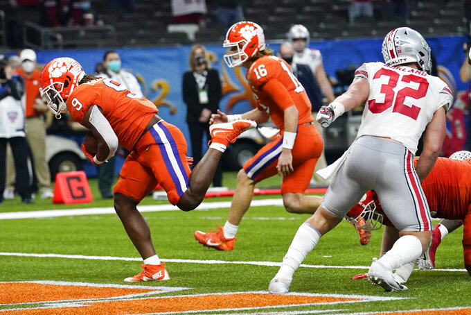 Clemson running back Travis Etienne scores against Ohio State during the first half of the Sugar Bowl NCAA college football game Friday, Jan. 1, 2021, in New Orleans. (AP Photo/Gerald Herbert)