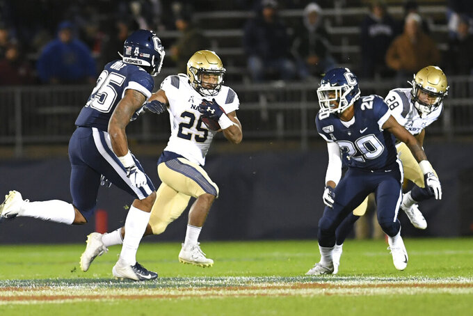 Midshipmen stay afloat in AAC title race with rout of UConn