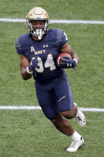 Navy fullback Jamale Carothers runs for a touchdown against Tulane during the first half of an NCAA college football game, Saturday, Oct. 26, 2019, in Annapolis. (AP Photo/Julio Cortez)