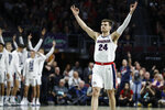 FILE - Gonzaga's Corey Kispert (24) celebrates after a teammate scored a 3-point shot against Saint Mary's in the first half of an NCAA college basketball game in the final of the West Coast Conference men's tournament in Las Vegas, in this Tuesday, March 10, 2020, file photo. The 6-foot-7 Kispert earned preseason AP All-America honors as he begins his final season with the top-ranked Bulldogs. (AP Photo/John Locher, File)