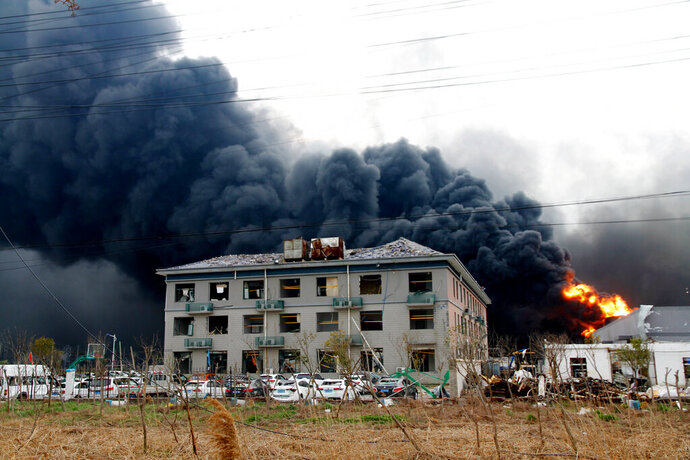In this Thursday, March 21, 2019, photo, fires burn at the site of a factory explosion in a chemical industrial park in Xiangshui County of Yancheng in eastern China's Jiangsu province. The local government reports the death toll in an explosion at a chemical plant in eastern China has risen with dozens killed and more seriously injured. (Chinatopix via AP)