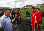Los Angeles Angels' Shohei Ohtani, second from right holding bat, speaks with coach Mike Scioscia during a spring training baseball practice on Tuesday, Feb. 13, 2018, in Tempe, Ariz. (AP Photo/Ben Margot)