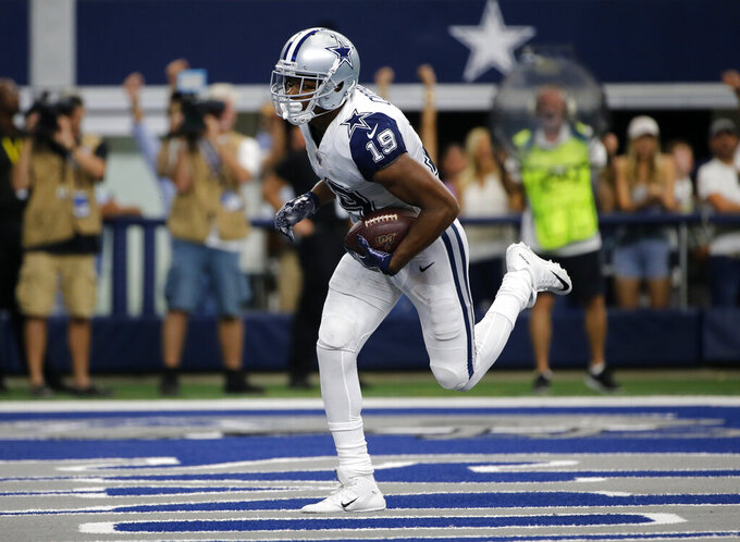 Dallas Cowboys wide receiver Amari Cooper (19) catches a pass in the end zone for a touchdown in the second half of an NFL football game against the Miami Dolphins in Arlington, Texas, Sunday, Sept. 22, 2019. (AP Photo/Michael Ainsworth)
