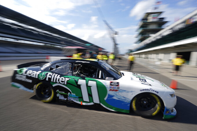 Justin Haley pulls into Gasoline Alley during practice for the NASCAR Xfinity Series auto race at Indianapolis Motor Speedway, Friday, Aug. 13, 2021, in Indianapolis. (AP Photo/Darron Cummings)