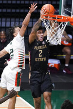 Florida State guard Anthony Polite (2) drives to the basket as Miami guard Isaiah Wong (2) tries to defend during the second half of an NCAA college basketball game, Wednesday, Feb. 24, 2021, in Coral Gables, Fla. (AP Photo/Marta Lavandier)