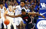 Lamar's Ellis Jefferson (3) struggles with the ball while pressured by Kentucky's Ashton Hagans (0) during the first half of an NCAA college basketball game in Lexington, Ky., Sunday, Nov. 24, 2019. (AP Photo/James Crisp)