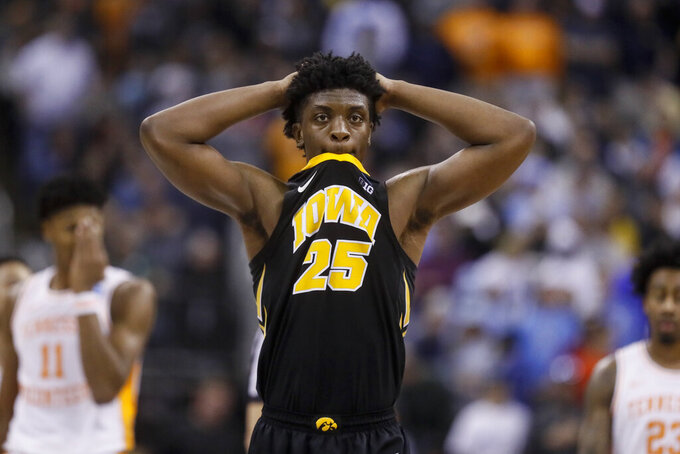Iowa's Tyler Cook (25) reacts in overtime during a second-round men's college basketball game in the NCAA Tournament against Tennessee, Sunday, March 24, 2019, in Columbus, Ohio. (AP Photo/John Minchillo)