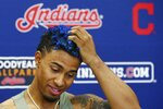 Cleveland Indians' Francisco Lindor talks about his injury and his new hair color at a news conference at the team spring training baseball facility Monday, Feb. 18, 2019, in Goodyear, Ariz. (AP Photo/Ross D. Franklin)