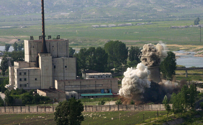 FILE - In this June 27, 2008 file photo released by China's Xinhua News Agency, the cooling tower of the Yongbyon nuclear complex is demolished in Yongbyon, North Korea, in a sign of its commitment to stop making plutonium for atomic bombs. When U.S. President Donald Trump and North Korean leader Kim Jong Un first met in Singapore in 2018, there was pomp, there was circumstance, but there wasn't much substance. As they get ready to sit down again in Vietnam on Feb. 27-28, 2019,  there's growing pressure that they forge a deal that puts them closer to ending the North Korean nuclear weapons threat. (Gao Haorong,/Xinhua via AP, File)
