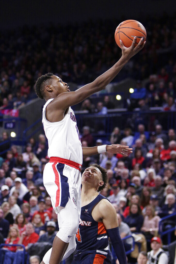 Gonzaga guard Joel Ayayi, left, shoots over Pepperdine guard Colbey Ross during the first half of an NCAA college basketball game in Spokane, Wash., Saturday, Jan. 4, 2020. (AP Photo/Young Kwak)