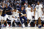 The Xavier bench reacts during the second half of an NCAA college basketball game against Cincinnati, Saturday, Dec. 7, 2019, in Cincinnati. (AP Photo/John Minchillo)