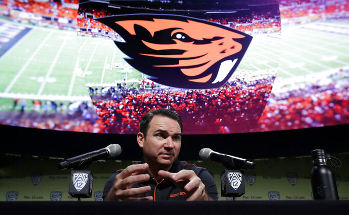 FILE - In this July 24, 2019, file photo, Oregon State head coach Jonathan Smith answers questions during the Pac-12 Conference NCAA college football Media Day in Los Angeles. The former Beavers quarterback knew what he was getting into when he took over after the disastrous 2017 season, when Oregon State won just a single game. He knows change will be incremental. (AP Photo/Marcio Jose Sanchez, File)
