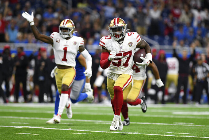 San Francisco 49ers linebacker Dre Greenlaw (57) returns an interception for a 39-yard touchdown against the Detroit Lions in the first half of an NFL football game in Detroit, Sunday, Sept. 12, 2021. (AP Photo/Lon Horwedel)