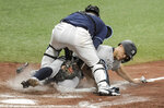 Tampa Bay Rays catcher Mike Zunino, left, tags out New York Yankees' Giancarlo Stanton at the plate as he tried to score from third base on an infield ground ball hit by New York's Gio Urshela during the eighth inning of a baseball game Tuesday, May 11, 2021, in St. Petersburg, Fla. (AP Photo/Steve Nesius)