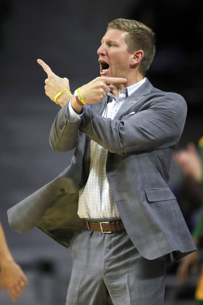 North Dakota State head coach David Richman calls for a switch during the first half of an NCAA college basketball game against Kansas State in Manhattan, Kan., Tuesday, Nov. 5, 2019. (AP Photo/Orlin Wagner)