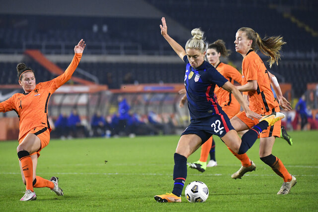 United States Kristie Mewis, number 22, scores her side's second goal during the international friendly women's soccer match between The Netherlands and the US at the Rat Verlegh stadium in Breda, southern Netherlands, Friday Nov. 27, 2020. (Piroschka van de Wouw/Pool via AP)