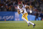 FILE - Southern California receiver Amon-Ra St. Brown runs with the ball during the second half of the Holiday Bowl NCAA college football game against Iowa in San Diego, in this Friday, Dec. 27, 2019, file photo. USC plays Arizona State at 9 a.m. Pacific time on Saturday, Nov. 7, 2020. (AP Photo/Orlando Ramirez, File)