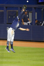 San Diego Padres right fielder Josh Naylor is unable to catch a ball hit by Miami Marlins' Harold Ramirez for a double scoring Yadiel Rivera and Cesar Puello during the second inning a baseball game, Tuesday, July 16, 2019, in Miami. (AP Photo/Wilfredo Lee)