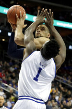 Seton Hall forward Michael Nzei (1) fouls Marquette forward Theo John as he goes up for a shot during the first half of an NCAA college basketball game, Wednesday, March 6, 2019, in Newark, N.J. (AP Photo/Julio Cortez)