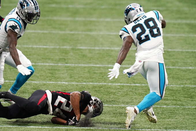 Carolina Panthers running back Mike Davis (28) runs against the Atlanta Falcons during the first half of an NFL football game, Sunday, Oct. 11, 2020, in Atlanta. (AP Photo/Brynn Anderson)