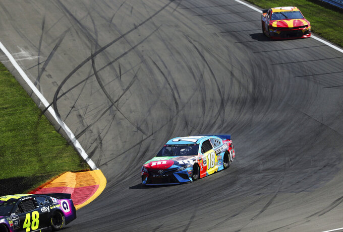 Kyle Busch heads into Turn 1 during a NASCAR Cup Series auto race at Watkins Glen International, Sunday, Aug. 4, 2019, in Watkins Glen, N.Y. (AP Photo/John Munson)