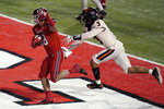 Utah wide receiver Britain Covey (18) scores against Oregon State defensive back Jaydon Grant (3) during the second half of an NCAA college football game Saturday, Dec. 5, 2020, in Salt Lake City. (AP Photo/Rick Bowmer)