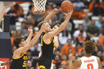 Iowa forward Riley Till (20) grabs a rebound during the team's NCAA college basketball game against Syracuse on Tuesday, Dec. 3, 2019, in Syracuse, N.Y. (Dennis Nett/The Post-Standard via AP)