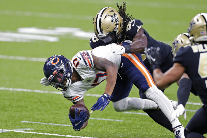 Chicago Bears wide receiver Anthony Miller (17) is tackled by New Orleans Saints outside linebacker Demario Davis (56) in the first half of an NFL wild-card playoff football game in New Orleans, Sunday, Jan. 10, 2021. (AP Photo/Brett Duke)