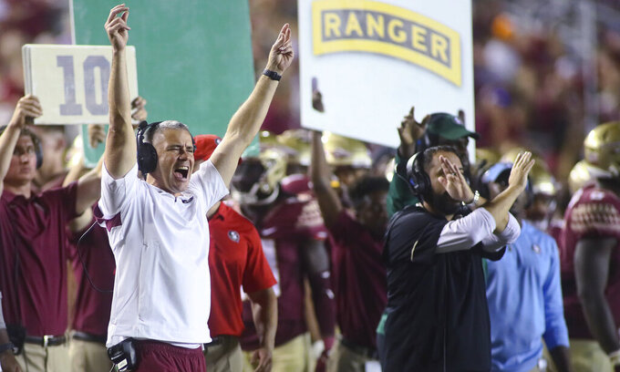 Florida State coach Mike Norvell gestures to the team as a play is called during the fourth quarter of an NCAA college football game against Jacksonville State on Saturday, Sept. 11, 2021, in Tallahassee, Fla. Jacksonville State won 20-17. (AP Photo/Phil Sears)