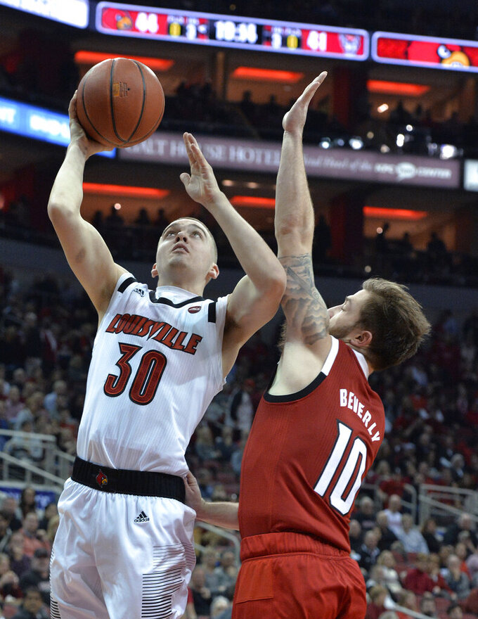 Louisville guard Ryan McMahon (30) shoots next to North Carolina State guard Braxton Beverly (10) during the second half of an NCAA college basketball game in Louisville, Ky., Thursday, Jan. 24, 2019. Louisville won 84-77. (AP Photo/Timothy D. Easley)